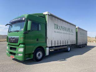 MAN TGX 18.440 camión con lona corredera + remolque con lona corredera